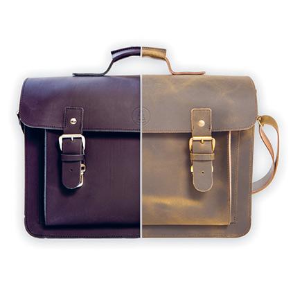 Mustassa laukussa soljet on valmistettu niklatusta kromista ja ruskeassa laukussa harjatusta messingistä.